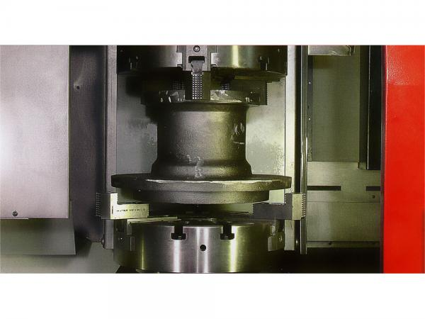 WORKPIECE EXCHANGE BETWEEN THE SPINDLE